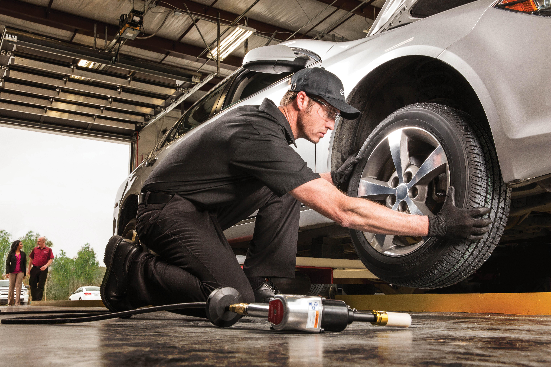 technician-changing-tire